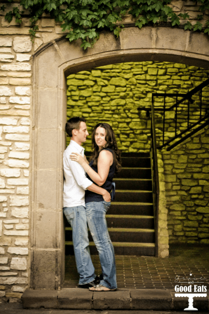man and woman standing at the bottom of stairs