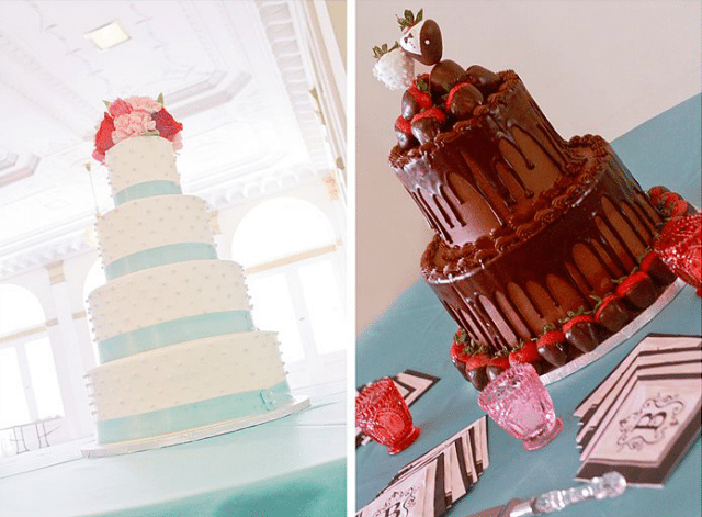 brides four tier wedding cake with blue ribbons and fresh flowers next to a chocolate grooms cake with chocolate covered strawberries