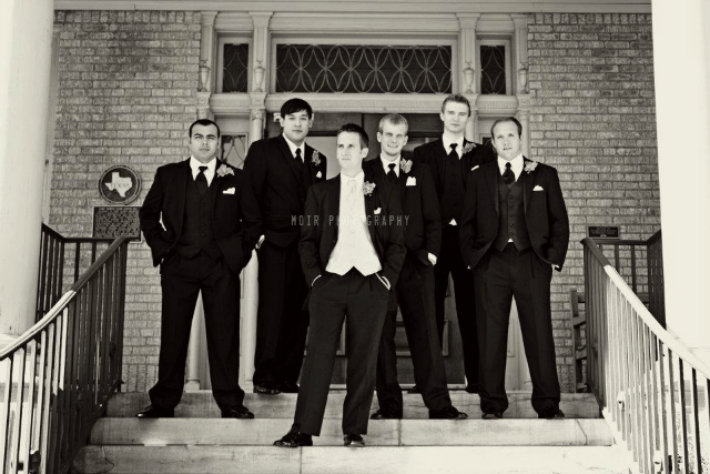groomsmen standing on chapel steps