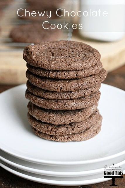 stack of chocolate cookies on white plates