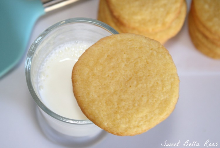 a vanilla instant pudding cookie resting on a glass of milk