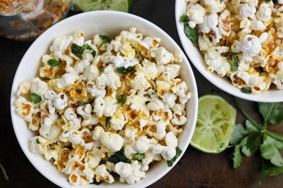 top view of savory cilantro popcorn in two white bowls
