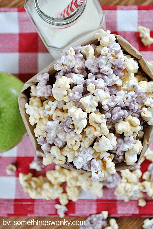 top view of PB&J sweet popcorn in a brown paper bag