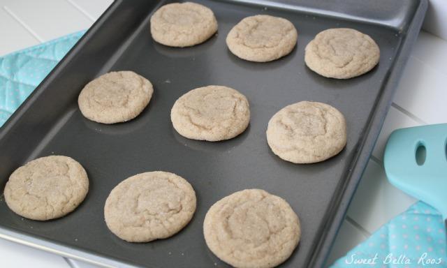 nine cinnamon cookies on a baking tray