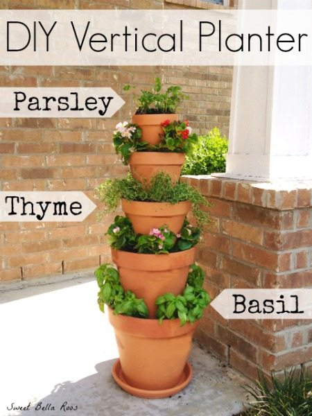 stacked flower pots with flowers and herbs