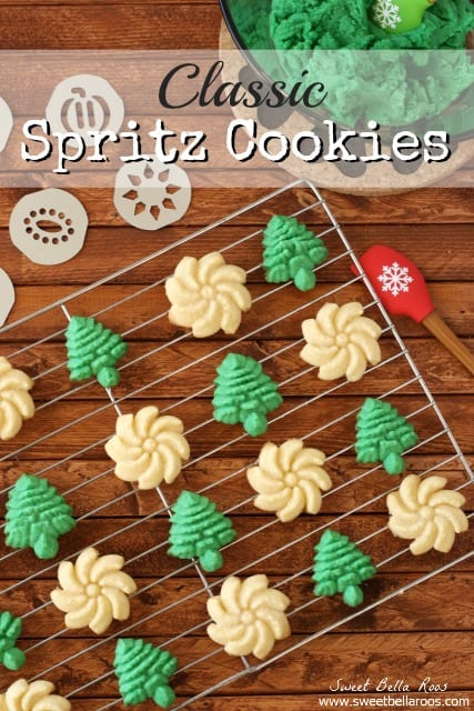 Spritz cookies lined up on a wire baking sheet