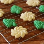 green and white Spritz cookies on a baking rack