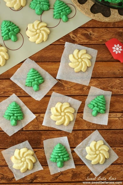 butter spritz cookies shaped as white flowers and green trees