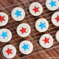 sugar cookies with sprinkles on a cooling rack