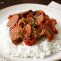 sausage, onions, and peppers over rice