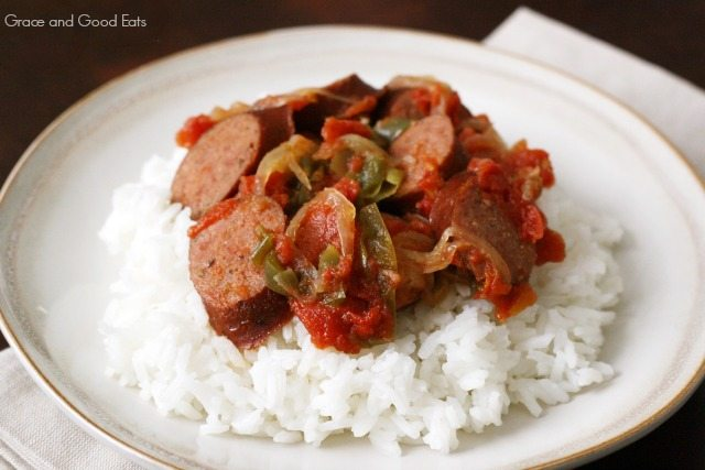 crockpot sausage and peppers with rice on a white plate