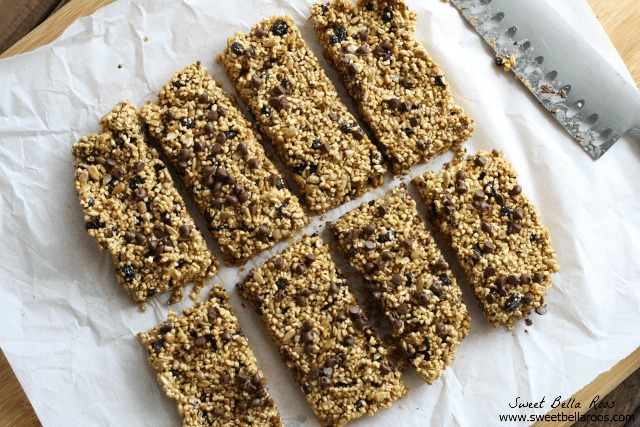 top view of gluten free granola bars , sliced on a cutting board