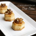 These Caramelized Pecan Brie Bites are full of creamy brie and topped with sugary sweet pecans for the perfect bite-size, individual appetizer!