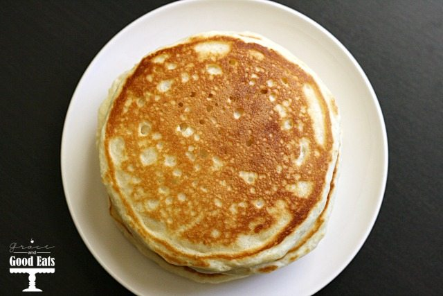 overhead shot of a stack of pancakes on a round plate