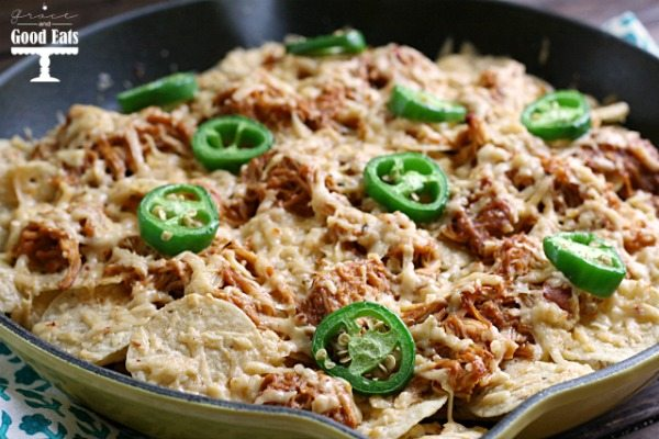 tortilla chips covered in cheese and shredded chicken