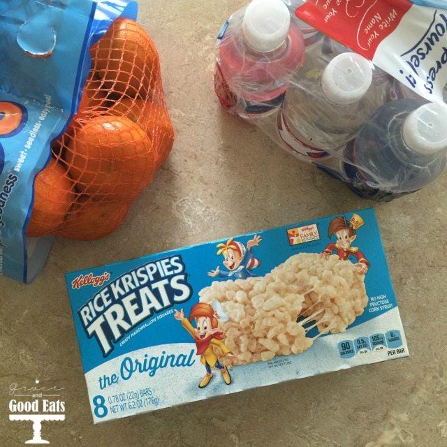 oranges, water, and box of rice krispie treats