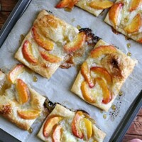puff pastry topped with brie, peaches, and honey