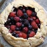 simple berry galette tart on a baking sheet