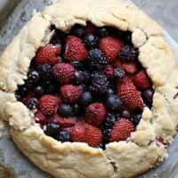 simple berry galette tart on a baking sheet