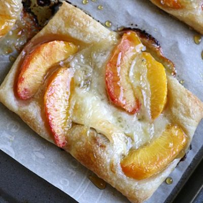 close-up puff pastry tart with peaches