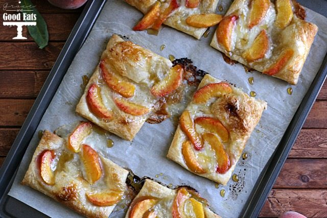 sheet pan full of peach pastry tarts