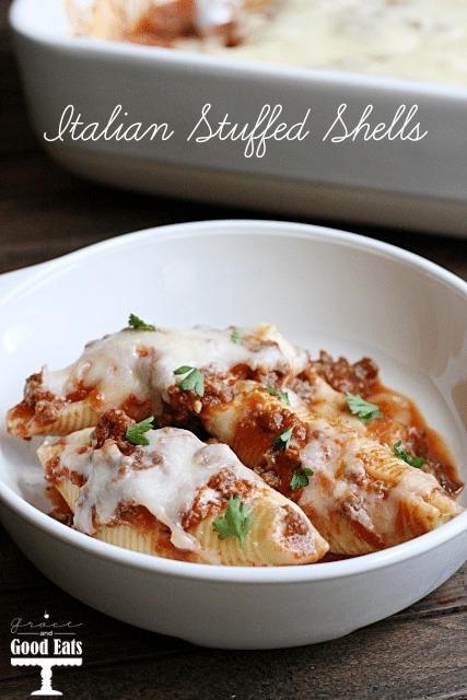 three italian stuffed shells in a white bowl