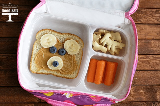teddy bear toast in a lunchbox with carrots and crackers