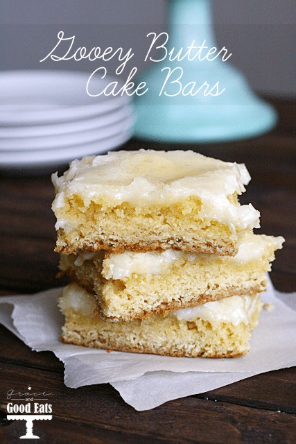 stack of three gooey butter bars on parchment paper