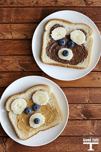 teddy bear toast made with peanut butter and hazelnut spread, bananas, and blueberries