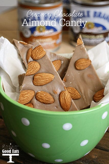 chocolate candy with almonds in a green bowl