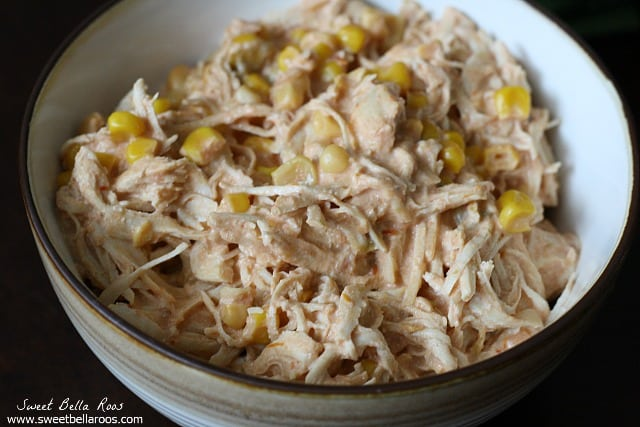 shredded chicken with corn in a white bowl
