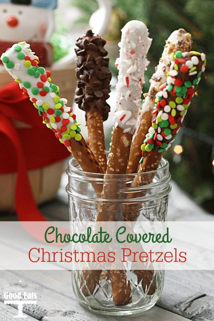 Five Christmas pretzels in a glass jar.
