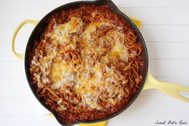 top view of baked skillet spaghetti in a yellow skillet