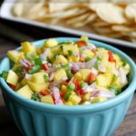 This Mango Salsa is refreshingly light and goes great with chips or crackers. Full of bright colors and bursts of flavor, it's perfect for a summer barbecue.