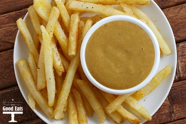 plate of french fries with dish of fry sauce