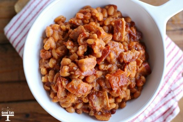 baked beans with bacon in white dish