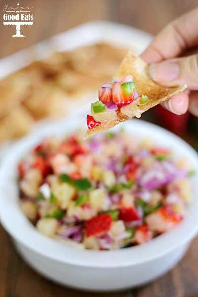 closeup of a cinnamon chip with a scoop of fruit salsa