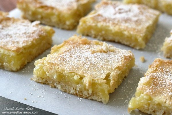 lemon bars cut into squares and dusted with powdered sugar