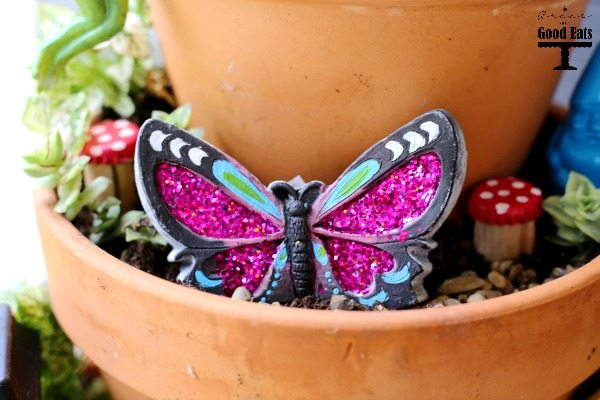 How to make your own DIY Fairy Garden with items from the dollar store! I wanted to make a fairy garden with my kids and we found tons of cute supplies (for cheap!) at the dollar store. Such an easy and fun outdoor garden craft for kids.
