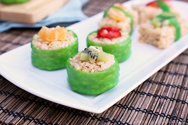 fruit sushi treats wrapped in fruit leather and topped with fresh kiwi