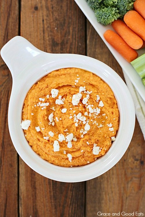 bowl of roasted red pepper hummus with feta