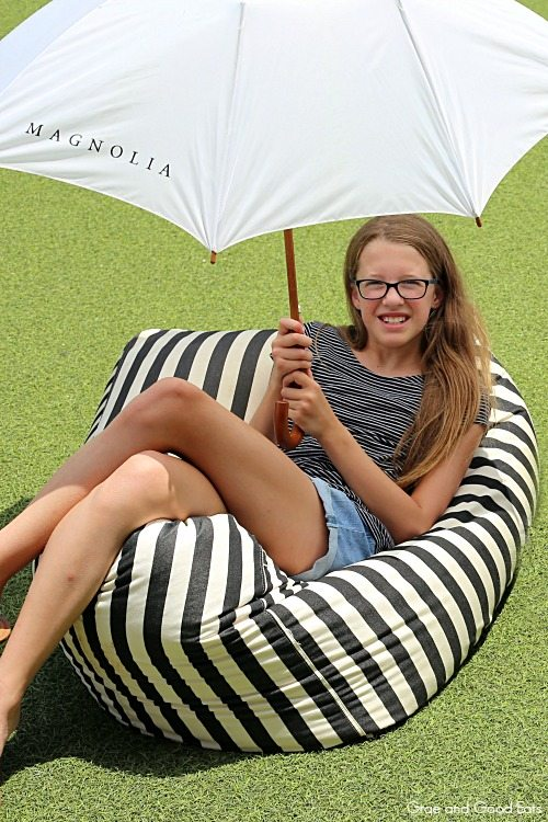 girl sitting on a black and white stripped bean bag chair