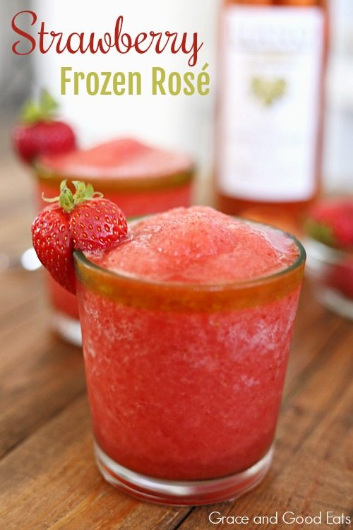 two glasses of frozen rose garnished with fresh strawberries