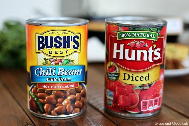 Cans of Bush's chili beans and Hunt's Diced Tomatoes