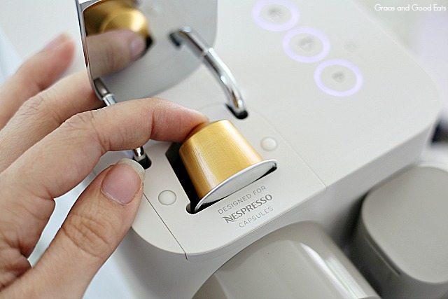 inserting a Nespresso pod into the Lattissima One