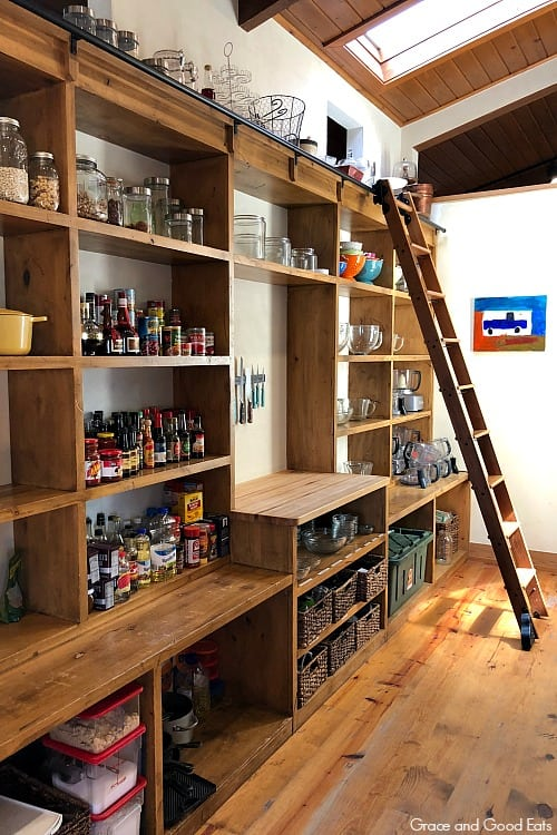 large pantry shelves with a ladder