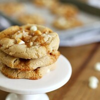These Salted Caramel Cookies are a match in caramel + flaky sea salt + white chocolate chip Heaven.  Not only do they taste amazing, but the recipe is incredibly easy (no need to soften butter or use a stand mixer).