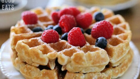 thick waffles topped with blueberries and raspberries