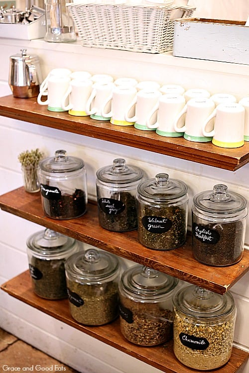 shelves with coffee cups and whole coffee beans