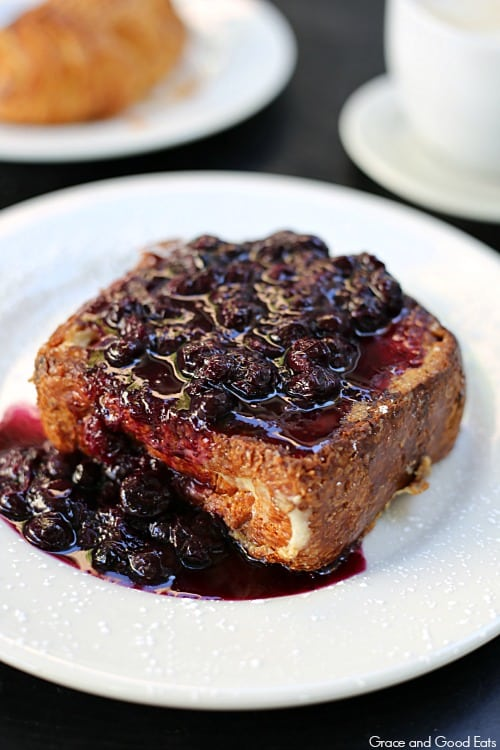 thick slice of stuffed French toast with a generous blueberry compote topping